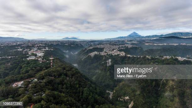 aerial view of landscape against sky - guatemala city stock pictures, royalty-free photos & images