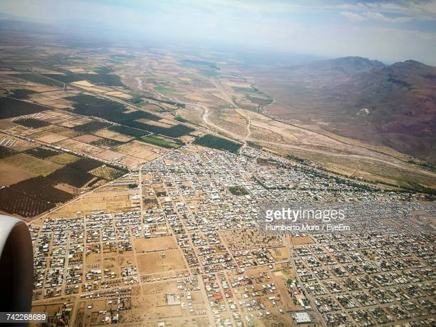 aerial view of landscape against sky - muro stock photos and pictures