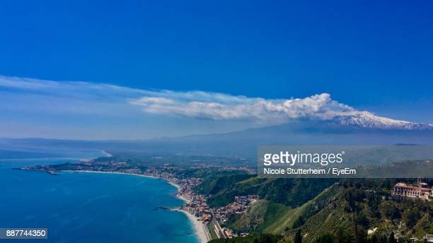 aerial view of landscape and sea against blue sky - stutterheim stock photos and pictures