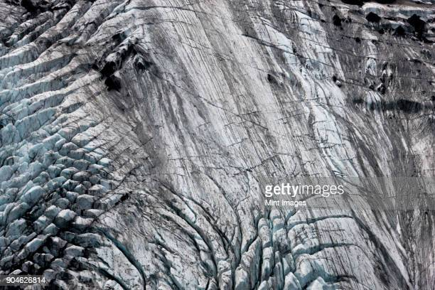 Aerial view of landscape with glacier and volcanic ash.
