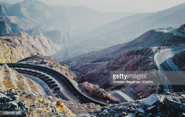 aerial view of landscape with mountain range in background - valley stock pictures, royalty-free photos & images