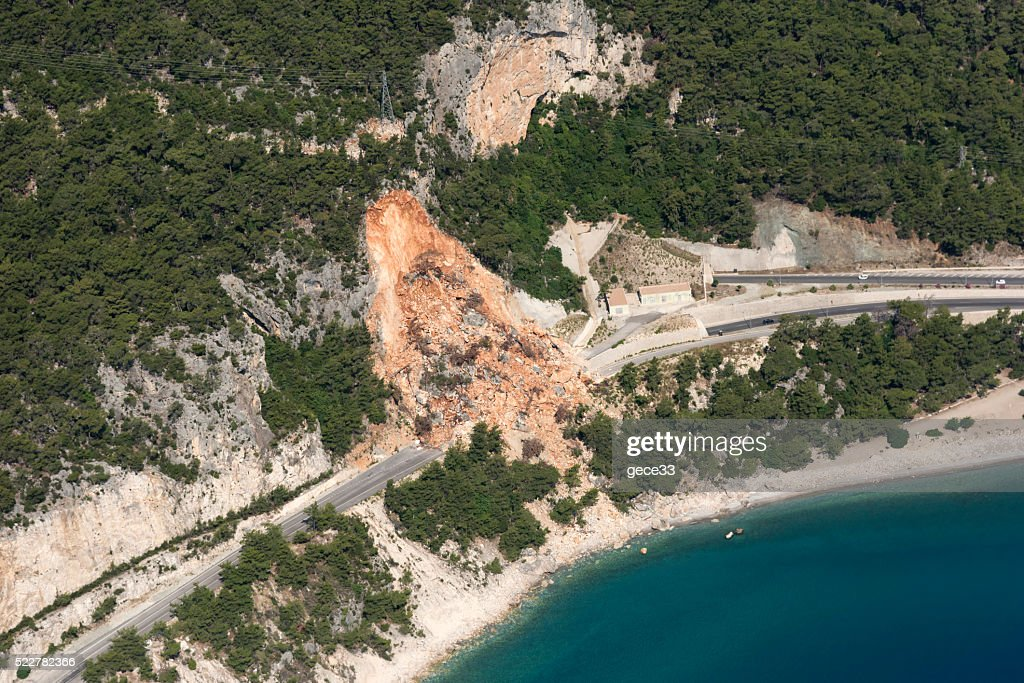 Aerial View of Landslides on road near the seaside : Stock Photo