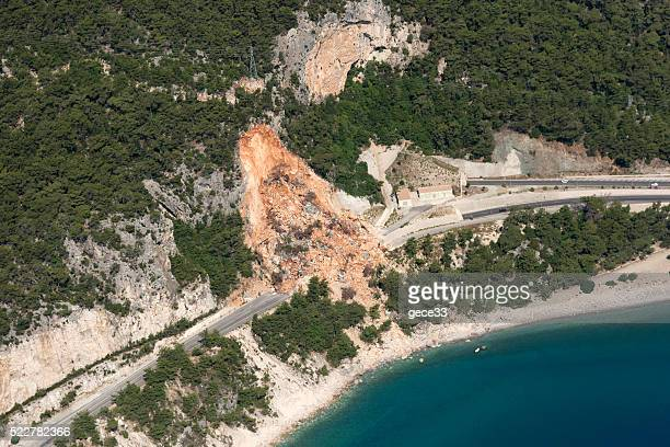 aerial view of landslides on road near the seaside - landslide stock pictures, royalty-free photos & images
