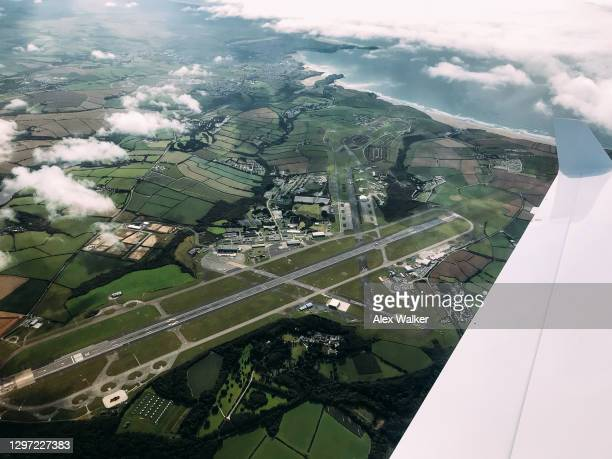 aerial view of large coastal airport - airport stock pictures, royalty-free photos & images