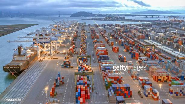 aerial view of large shipping docks in harbour, oakland, california - oakland california stock pictures, royalty-free photos & images