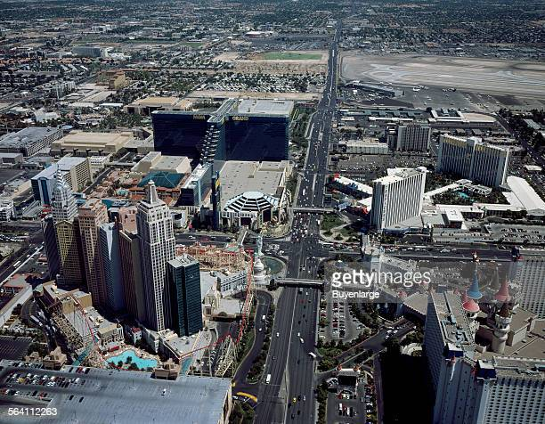 Aerial view of Las Vegas Nevada looking toward the airport and down upon the turreted towers of the Excalibur Hotel and Casino lower right