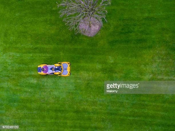 aerial view of lawn tractor or riding mower. directly above. drone view. - lawn mower stock pictures, royalty-free photos & images