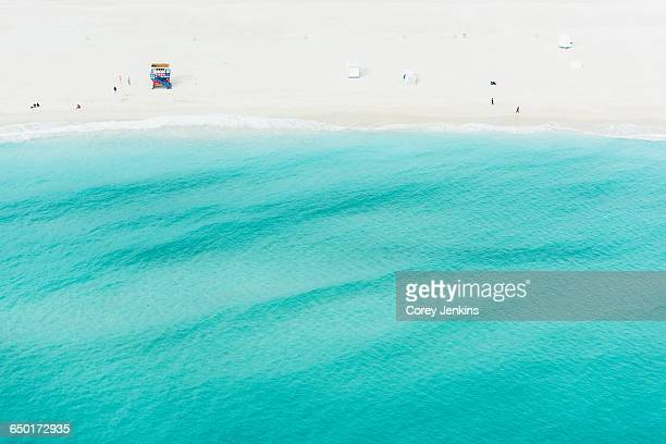 Aerial view of lifeguard tower and tourists by coastline, South beach, Miami, Florida, USA