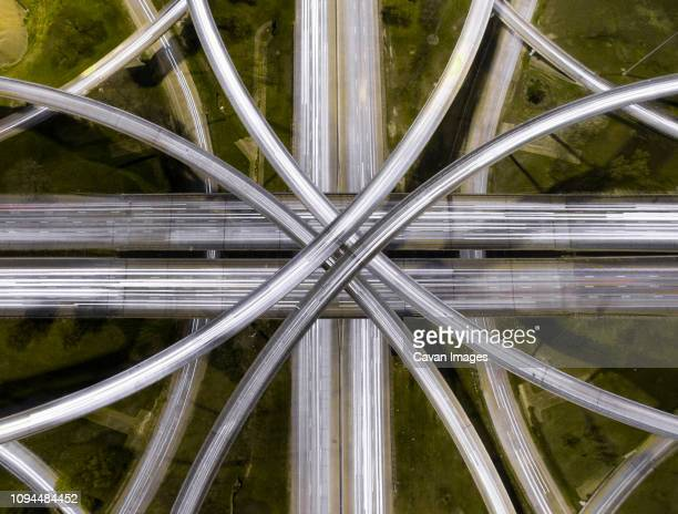 aerial view of light trails on road intersections in city - houston texas fotografías e imágenes de stock