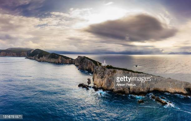 aerial view of lighthouse at cape ducato in lefkada island, greece. - cape stock pictures, royalty-free photos & images