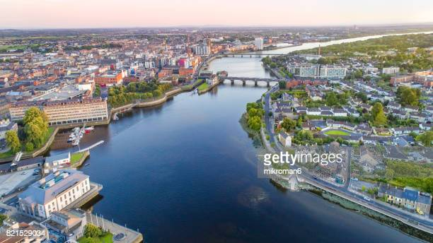 aerial view of limerick city centre at sunset time,  ireland. - limerick city stock-fotos und bilder