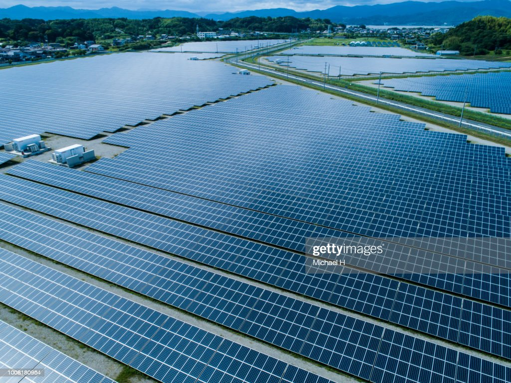 Aerial view of lined up solar panels : ストックフォト