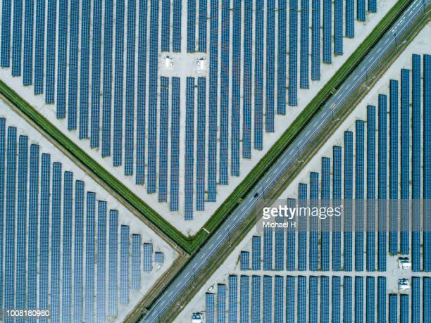 aerial view of lined up solar panels - solar powered station stock pictures, royalty-free photos & images