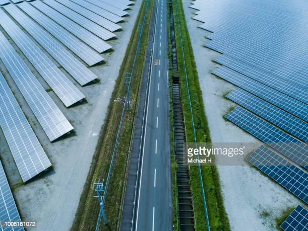aerial view of lined up solar panels - sustainable development goals stock pictures, royalty-free photos & images