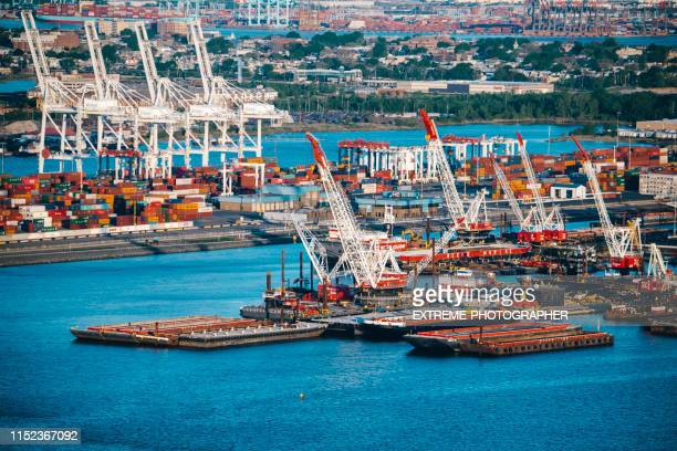 aerial view of loading piers with hoist cranes of jersey docks - newark new jersey stock pictures, royalty-free photos & images
