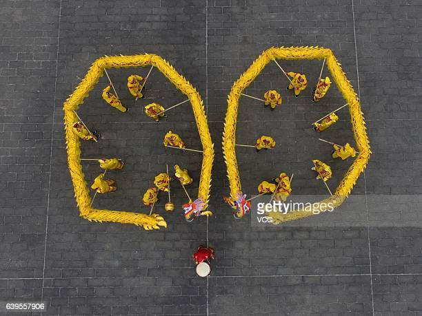 Aerial view of local artists practicing dragon dance on January 22 2017 in Zunyi Guizhou Province of China Chinese people perform dragon dance lion...