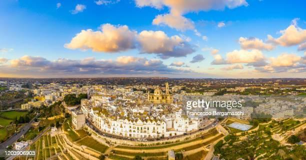aerial view of locorotondo village at sunset. - bari foto e immagini stock