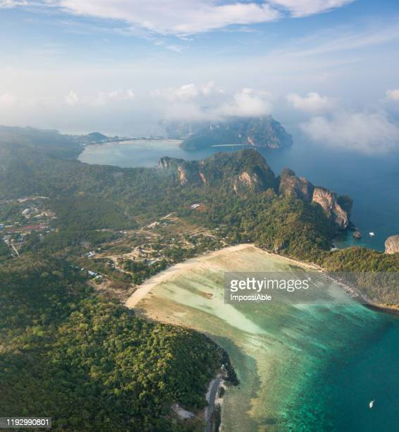 aerial view of loh lana bay and phi phi don island with the misty in the morning, andaman sea , krabi, thailand - impossiable stock pictures, royalty-free photos & images