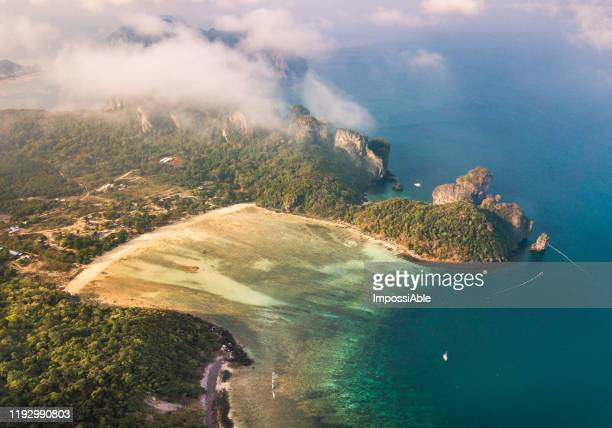 aerial view of loh lana bay near phi phi don island with the misty in the morning, andaman sea , krabi, thailand - impossiable stock pictures, royalty-free photos & images