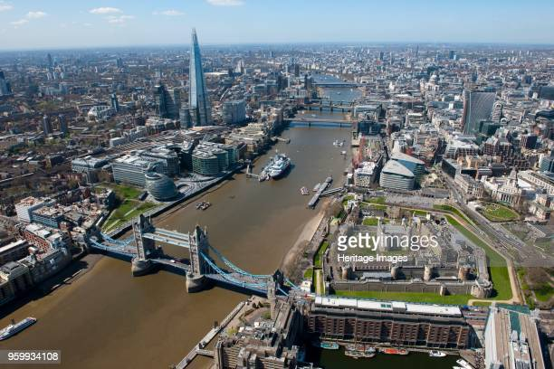 Aerial view of London 2013 View showing the River Thame Tower Bridge the Tower of London the Greater London Authority Building and The Shard Artist...