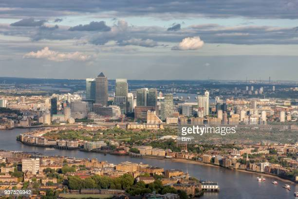 aerial view of london at sunset, thames river, canary wharf - london docklands stock pictures, royalty-free photos & images