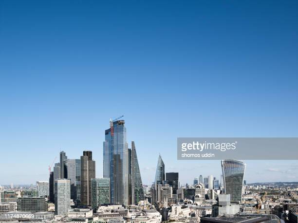 aerial view of london city skyline on a clear sunny day - blue stock pictures, royalty-free photos & images