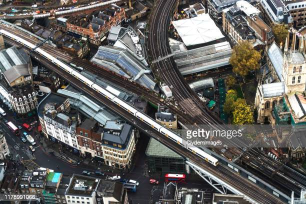 aerial view of london city through the shard's observation point in uk - high angle view of a public overground train moving on railroad track in london - high street stock pictures, royalty-free photos & images
