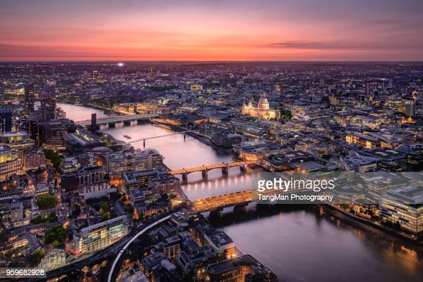 aerial view of london cityscape with river thames at twilight - britain stock pictures, royalty-free photos & images