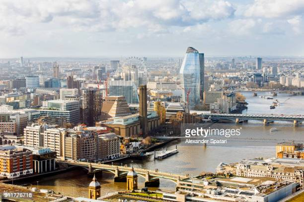 Aerial view of London South Bank with London Bridge, Tate Modern Museum, Millenium Bridge and One Blackfriars skyscraper
