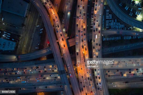 aerial view of los angeles arterial roads at twilight time - traffico foto e immagini stock