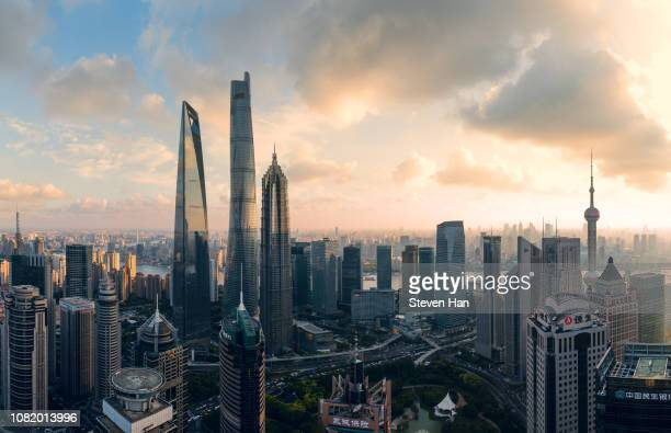 aerial view of lujiazui in shanghai at dusk - lujiazui stock pictures, royalty-free photos & images