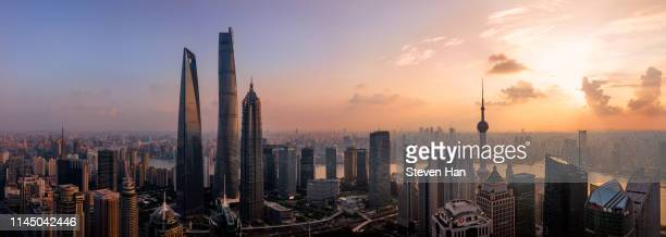 aerial view of lujiazui in shanghai at dusk - clear sky stock pictures, royalty-free photos & images