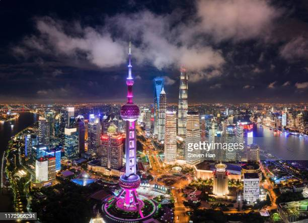 aerial view of lujiazui in shanghai at night - pudong stock pictures, royalty-free photos & images
