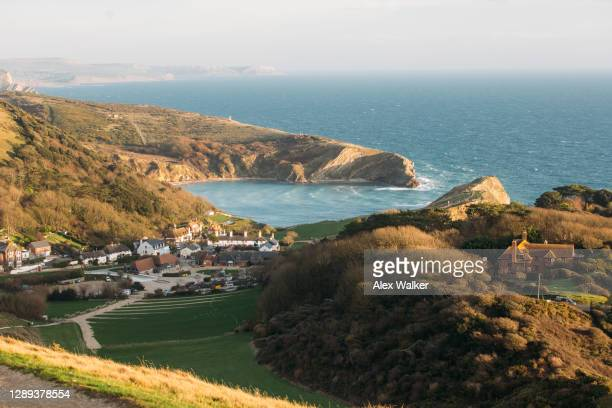 aerial view of lulworth cove sunset - dorset england stock pictures, royalty-free photos & images