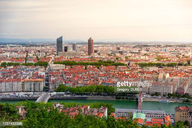aerial view of lyon french cityscape with saone river and red rooftops and la part-dieu business district - lyon stock pictures, royalty-free photos & images