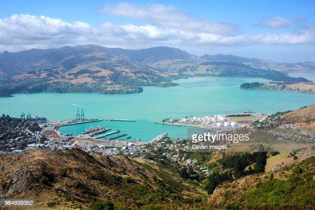 aerial view of lyttelton harbour amidst landscape on sunny day - christchurch new zealand stock pictures, royalty-free photos & images