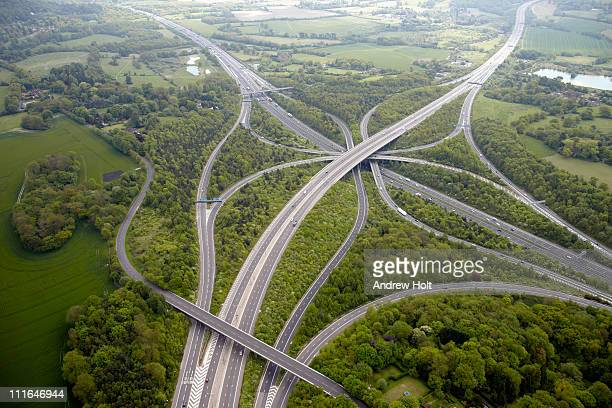 aerial view of m23 m25 motorway junction - road junction stock pictures, royalty-free photos & images