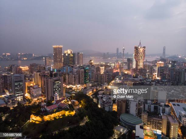 aerial view of macau skyline with the guia fortress - macao stock pictures, royalty-free photos & images