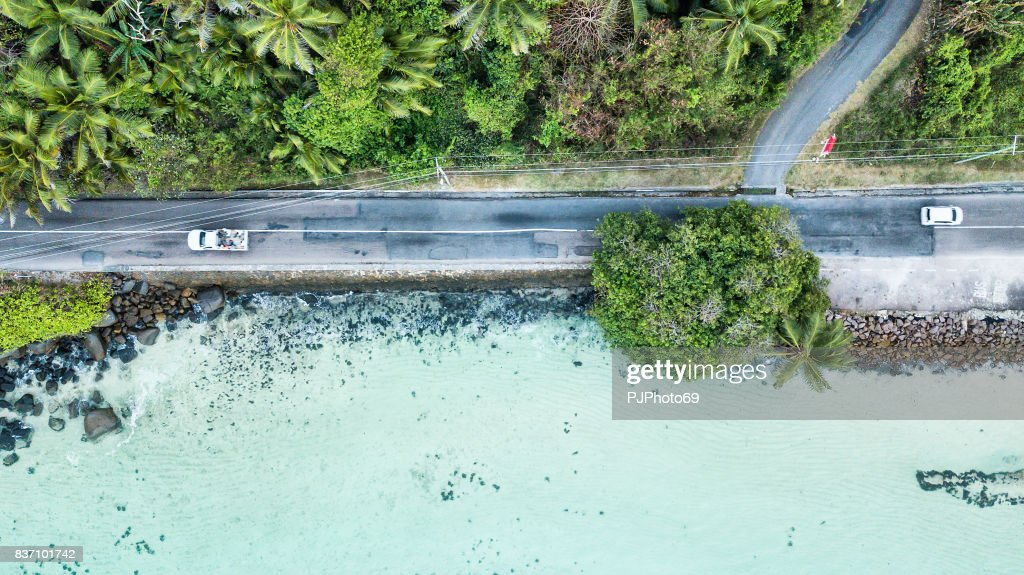 Aerial view of main road of Mahe Island on the sea - Seychelles : Stock Photo