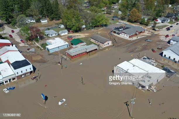 Aerial view of main street that is flooded after water from the Tittabawassee River breached a nearby dam on May 20, 2020 in Sanford, Michigan....