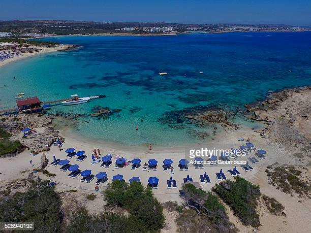 Aerial view of Makronissos Beach with crystal clear waters and golden sands on April 29 2016 in Ayia Napa Cyprus All the beaches are soft white sand...