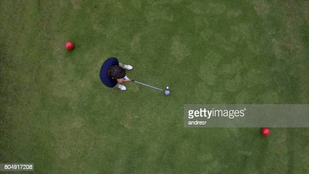 Aerial view of man playing golf and standing on the tee box