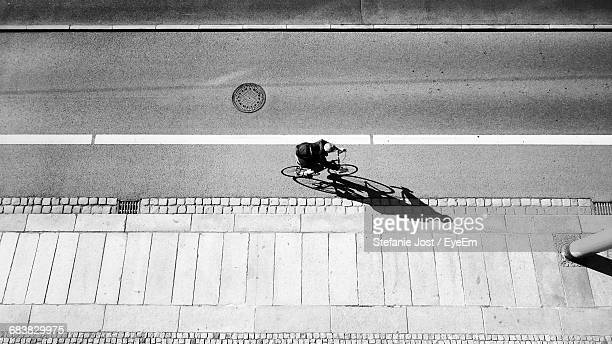 Aerial View Of Man Riding Bicycle On Road