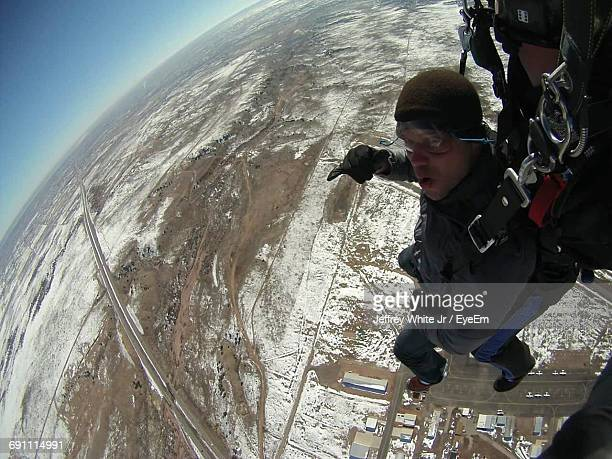 Aerial View Of Man Skydiving Over Landscape
