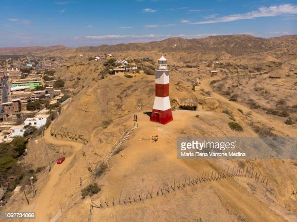 aerial view of mancora lighthouse over arid hill - mancora fotografías e imágenes de stock