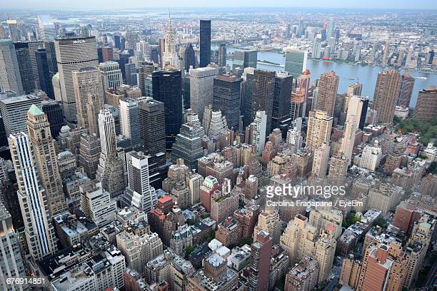 aerial view of manhattan against sky - carolina fragapane stock pictures, royalty-free photos & images