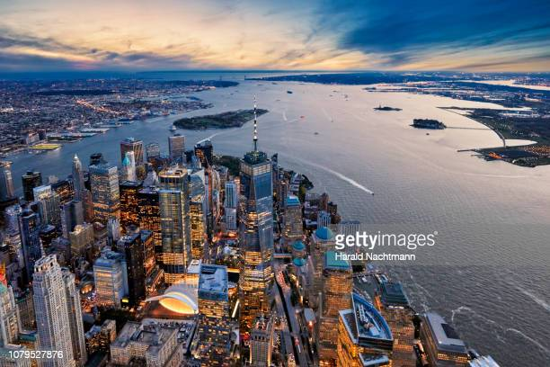 aerial view of manhattan island and harbor at dusk, new york city, new york state, united states - lower manhattan stock pictures, royalty-free photos & images