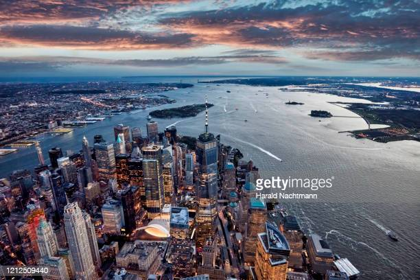 aerial view of manhattan island and harbor at sunset, new york city, new york state, united states - hudson river stock pictures, royalty-free photos & images