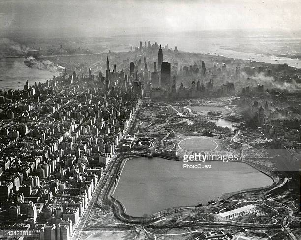 Aerial View of Manhattan Island looking from Central Park Reservoir down to the tip of the Island New York New York 1953 The Hudson River is on the...