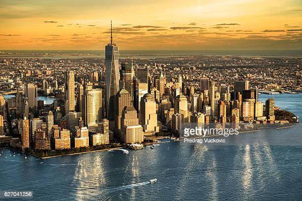 aerial view of manhattan island - world trade center manhattan stock pictures, royalty-free photos & images